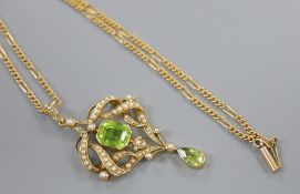 An Edwardian gold, seed pearl and two stone peridot set scroll pendant, overall 53mm, gross 7.4