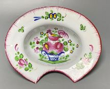An early 19th French faience barber's bowl, brightly enamelled, width 26cmCONDITION: Very good