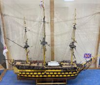 A model of the HMS Victory in perspex case, approximate length 120cm