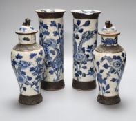 A part garniture of 19th century Chinese blue and white crackleglaze vases consisting a pair of