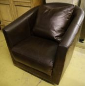 A modern brown leather swivel armchair