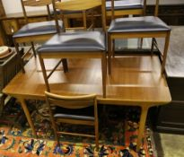A teak dining suite by A. H. McIntosh & Co. Ltd, Kirkcaldy comprising extending table, set of chairs