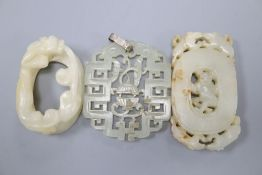 Two Chinese white jade carvings, 6.5cm and 5cm, and a Chinese pale celadon jade pendant, 5.