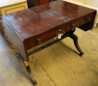 A Regency mahogany sofa table, with ebony stringing, and two frieze drawers, width 97cmCONDITION: Of