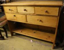A pine five drawer side cabinet, width 117cm depth 40cm height 87cm