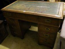 A Victorian walnut military pedestal desk, stamped Arthur Foley & Sons, Salisbury 1894, width