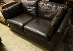 A modern brown leather two seat sofa, width 190cm depth 100cm