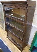 An early 20th century oak Globe Wernicke-style oak four section bookcase, width 87cm depth 36cm
