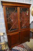 A Georgian style mahogany glazed bookcase, width 116cm, depth 44cm, height 194cm