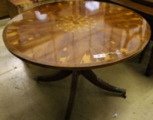 A reproduction oyster veneered and yew wood circular breakfast table, diameter 114cm height 74cm