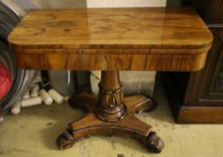 An early Victorian rosewood card table, having D-shaped folding top lined with foliate-decorated