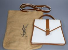 An Yves St Laurent handbag, complete with maker's bag and shoulder strapCONDITION: Rear side with