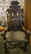 A late 19th century Flemish carved oak elbow chair, width 88cm height 150cm