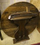 An oak circular table raised on lyre supports, diameter 110cm, height 73cm