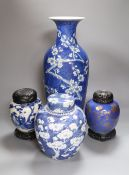 Three Chinese blue and white jars and a tall vase, late 19th/early 20th century, tallest vase 44.