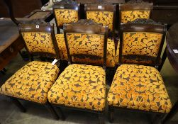 A set of six early 19th century Anglo-Indian rosewood dining chairs, with carved frames and padded