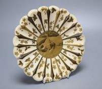 A Japanese Meiji period ivory and lacquered chrysanthemum form dish, diameter 20cmCONDITION: Some