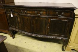 A 1920's Chippendale revival mahogany bowfront sideboard, width 152cm depth 63cm height 100cm