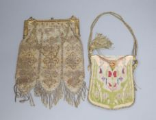 A silver and gold beadwork evening purse, 27cm and a needlework evening purse, 16cmCONDITION: