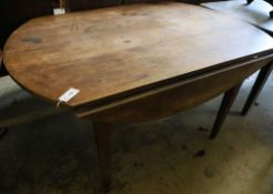 A 19th century French cherrywood circular drop leaf kitchen table, 144 x 104cm height 74cm