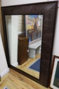 An Andrew Martin faux crocodile rectangular wall mirror, width 116cm height 148cm