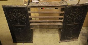 A Victorian cast iron grate, with decorative side panels, in two parts, width 97cm height 85cm