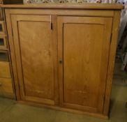 A late Victorian pine two door cupboard, width 123cm depth 52cm height 125cm