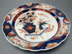 A 19th century Imari dish, painted in typical palette, 30.5cm diameterCONDITION: There is slight