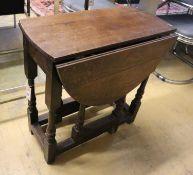 A small oak gateleg table, width 65cm, depth 34cm, height 66cm