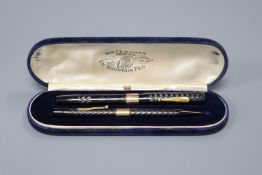 A 9ct gold mounted Waterman's fountain pen together with a similar pencil