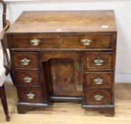 A mid 18th century walnut kneehole desk, width 76cm, depth 43cm, height 73cm