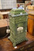 A French green enamelled cast iron heater, 60cm high
