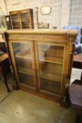 A Victorian parcel gilt walnut inverse breakfront bookcase, width 112cm, depth 27cm, height 118cm