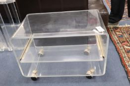 A 1970s lucite wheeled stand, width 65cm x depth 40cm, height 47cm