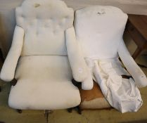 A near pair of late Victorian upholstered open armchairs