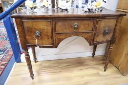A small Regency mahogany bow front sideboard, width 107cm, depth 50cm, height 82cm