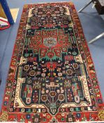 A Persian red ground rug, 282 x 134cm