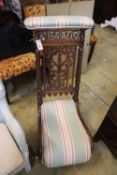 A Victorian carved mahogany prie dieu chair
