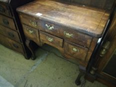 An early 18th century walnut lowboy, fitted four drawers, width 74cm, depth 44cm, height 71cm