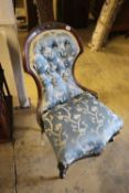 A Victorian walnut show wood upholstered nursing chair on casters