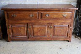 An 18th century style oak low dresser, width 168cm, depth 58cm, height 86cm