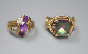 A 9ct gold and tourmaline? dress ring with fancy mount, size L/M and a 9ct gold, amethyst and