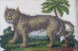 A Victorian needlework panel of a lion