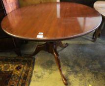 A mahogany snap-top tea table, diameter 106cm height 75cm