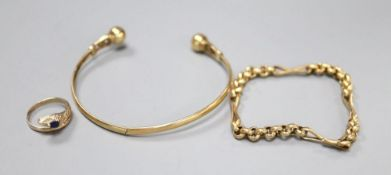A yellow metal bangle, a yellow metal small chain bracelet, 15cm and a yellow metal gem set '