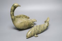 A carved Inuit whale and a similar carved swan