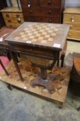 A Victorian rosewood topped games / work table, width 44cm, depth 33cm, height 73cm