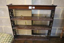 A George III style mahogany three shelf wall bracket, width 74cm, depth 16cm, height 67cm