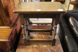 An 18th century style oak joint stool, width 46cm, depth 25cm, height 48cm