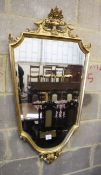 A gilt framed shield shape wall mirror, 56 x 110cm